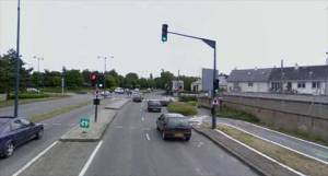 Rennes, France: Bike paths merging in general traffic at intersection, and resuming after it